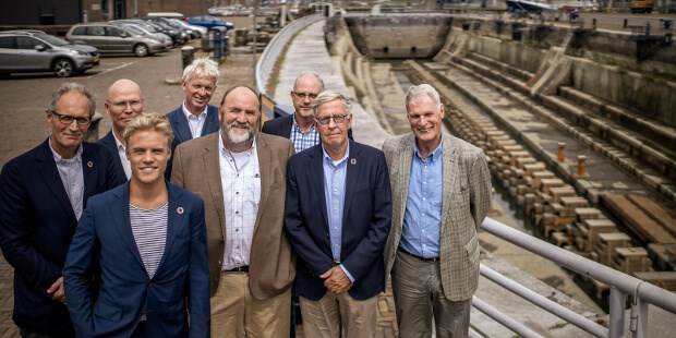 The delegates of the press conference at the dock that will welcome the 'Stad Amsterdam' at historic Willemsoord harbour at DSDH