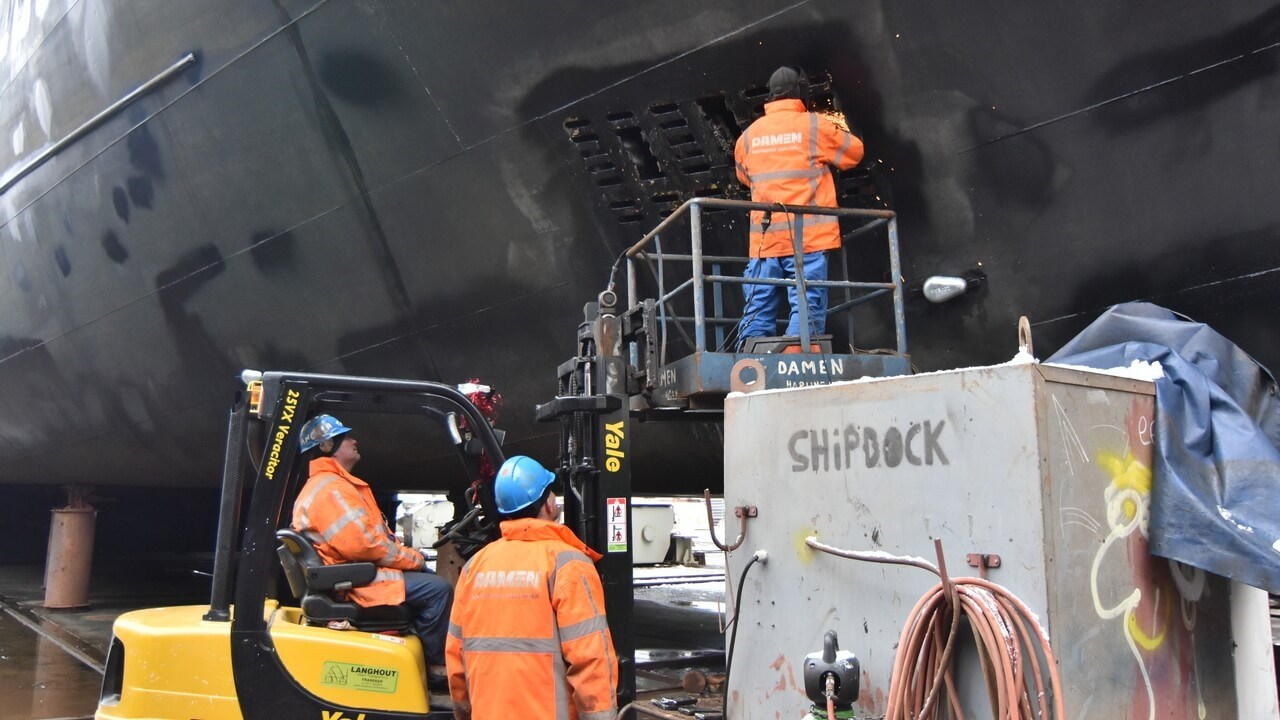 The hull was high-pressure cleaned and there was some touching up of the paint on the hull and topsides